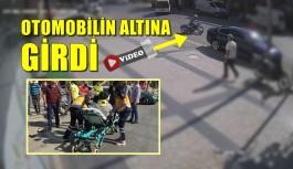 MOTOSİKLET SÜRÜCÜSÜ PARK HALİNDEKİ OTOMOBİLİN ALTINA GİRDİ